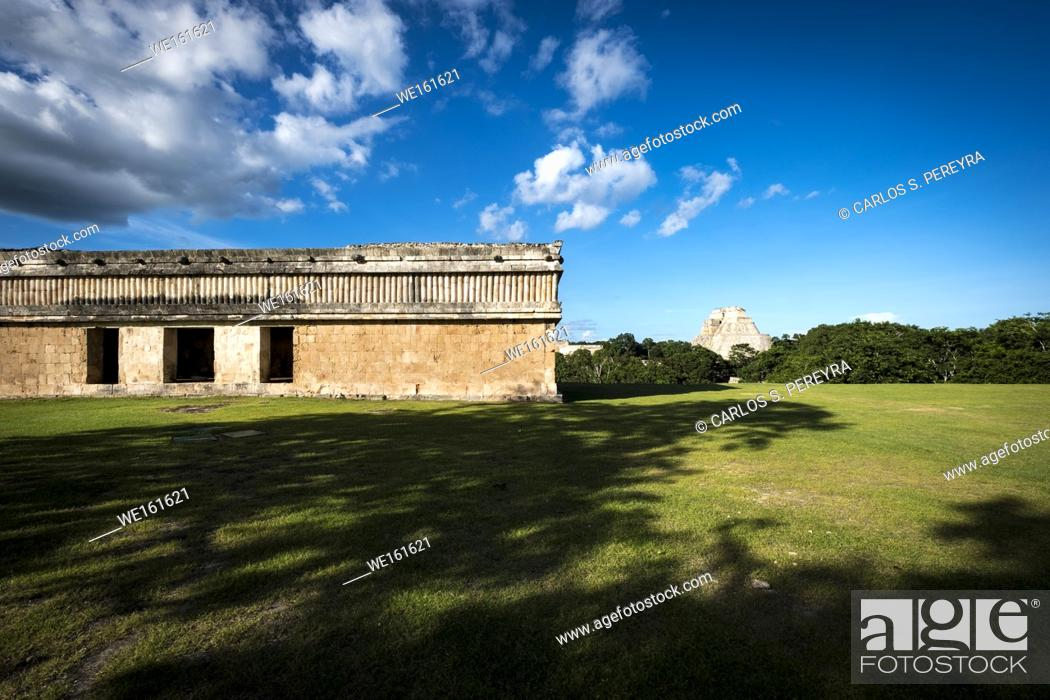 Stock Photo: The Pyramid of the Magician (Pirámide del Mago) towering in the Maya City of Uxmal, Mexico.