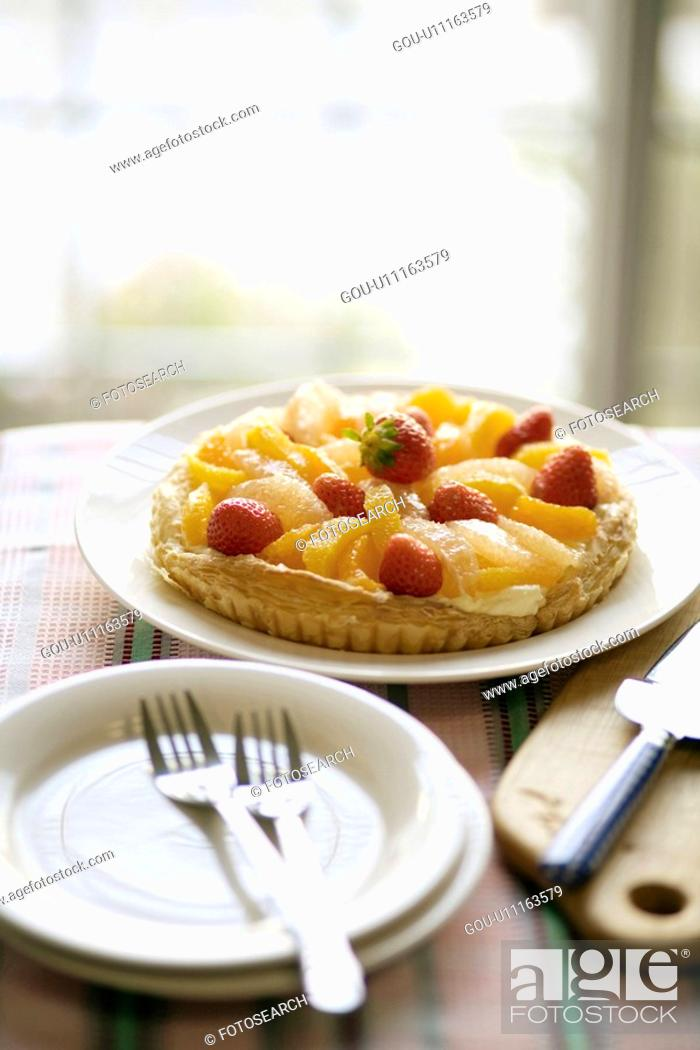 Stock Photo: Fruit tart ready to be served.