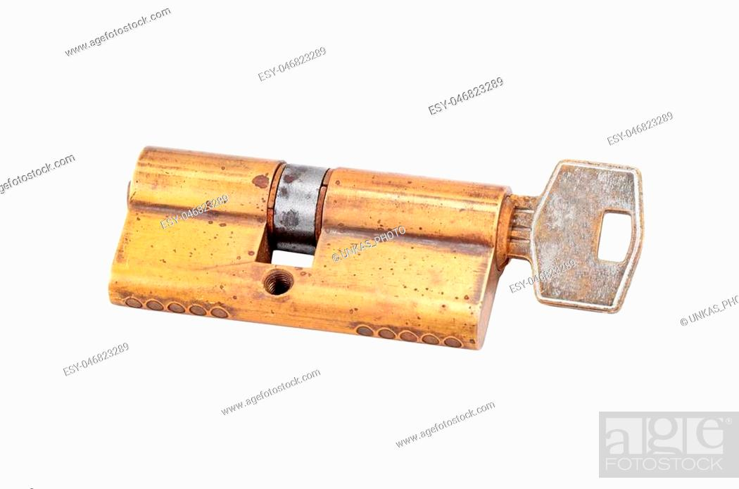 Photo de stock: Door lock cylinder core with key, isolated on white background.