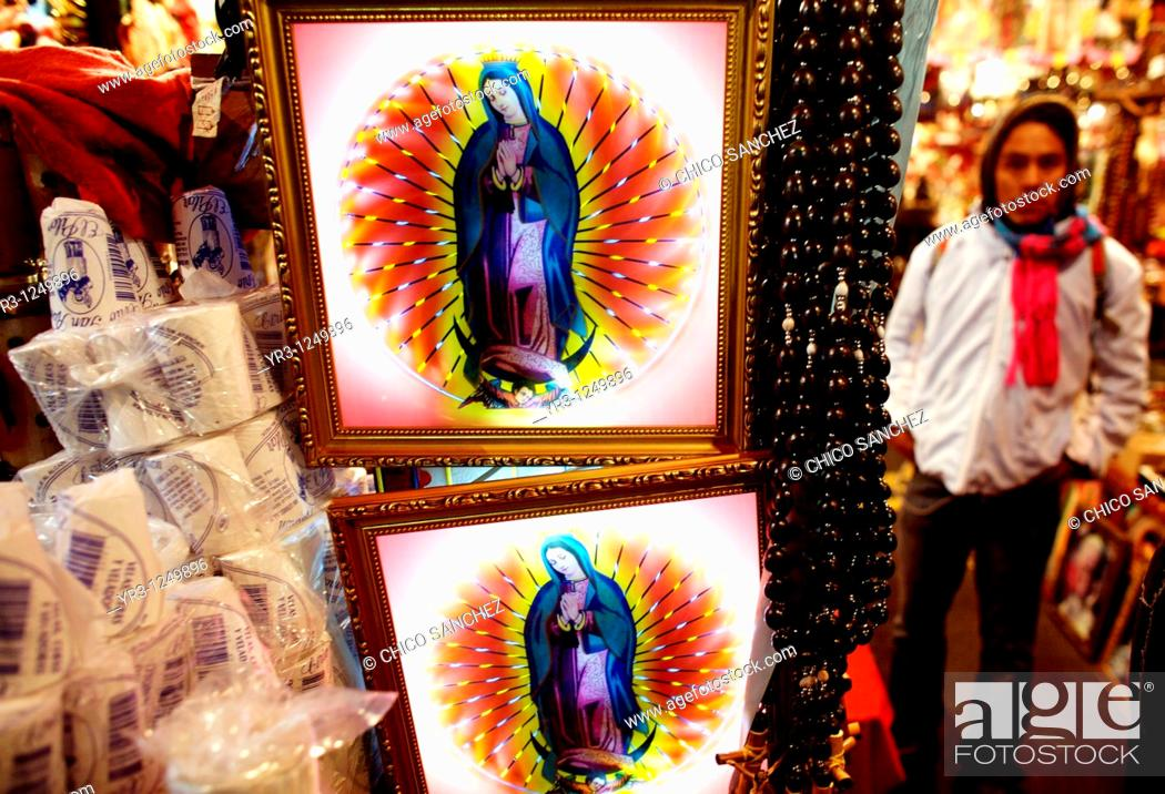 Stock Photo: Souvenirs hang for sale outside the Basilica of Guadalupe in Mexico City. Hundreds of thousands of Mexican pilgrims converged on the Basilica.
