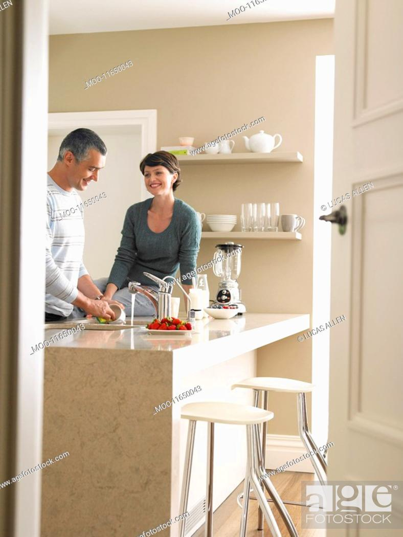 Stock Photo: Married Couple in Kitchen.
