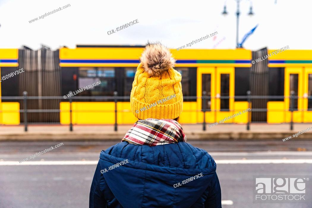 Stock Photo: Woman looking at tram passing by, Budapest, Hungary.