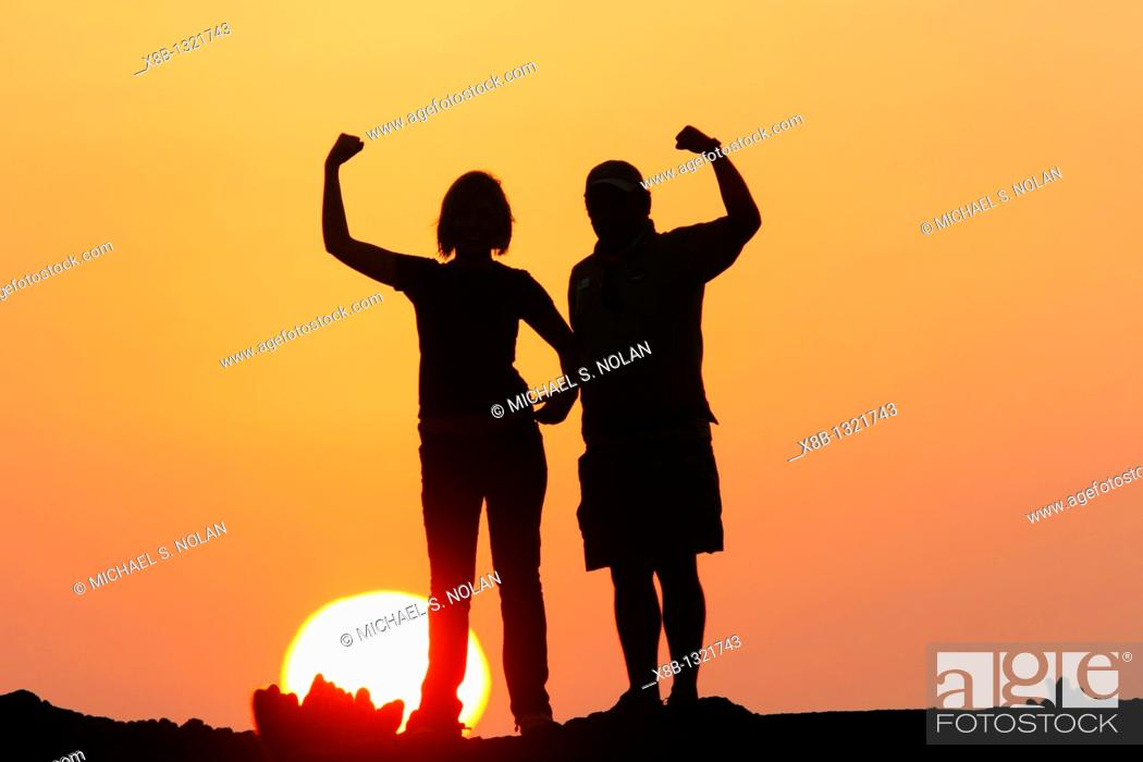 Stock Photo: Sunset in the Galapagos on a young couple.