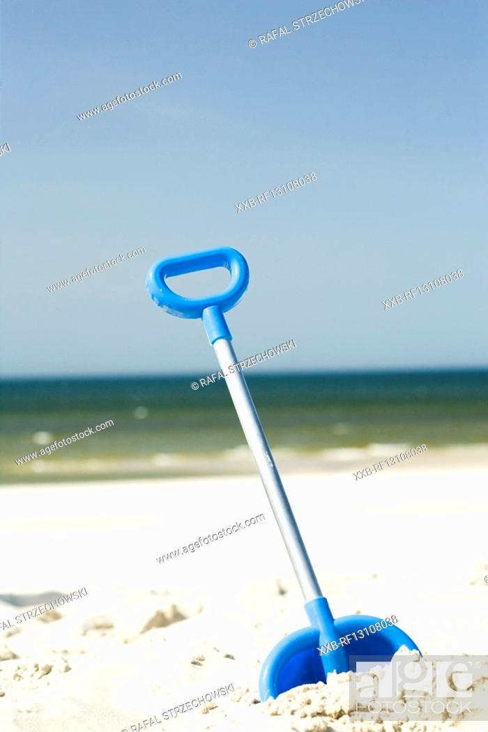 Stock Photo: little shovel on beach.