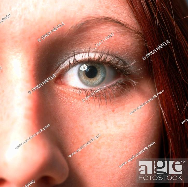 Stock Photo: Green Eye of a young Woman.