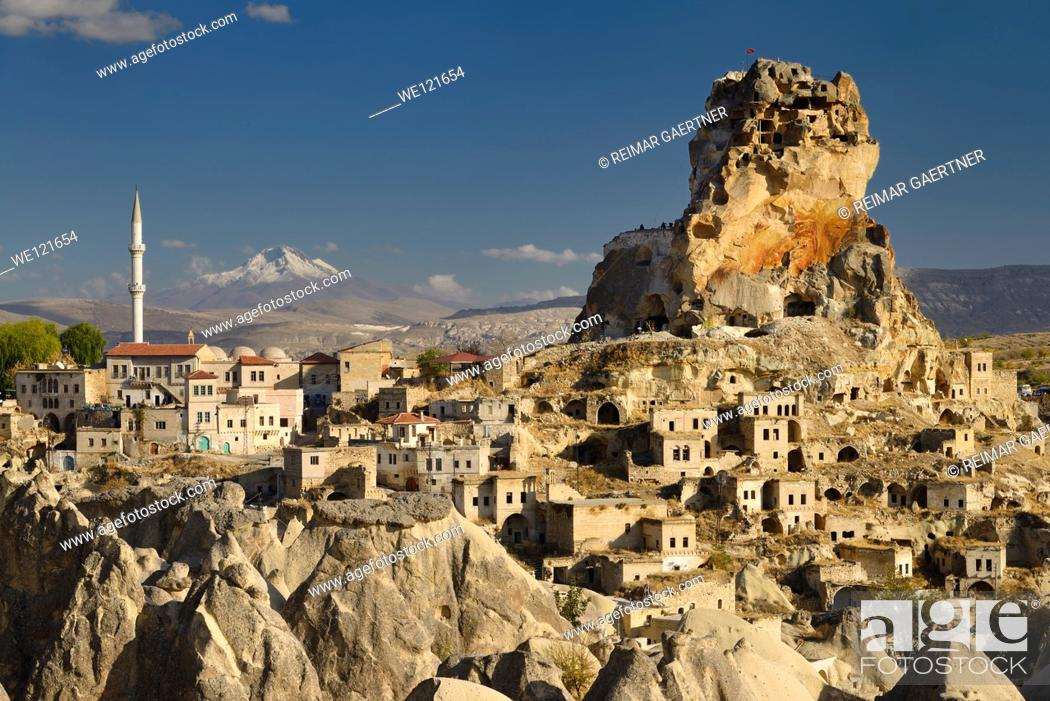 Stock Photo: View of Ortasihar rock Castle with minaret Mount Erciyes and fairy chimneys Cappadocia Turkey.