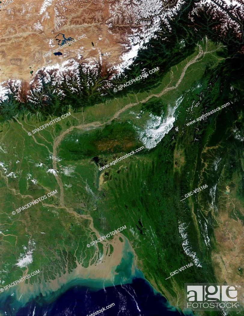 Stock Photo: In This true-color image from October 23, 2001, the semi-arid Tibetan Plateau upper left meets up with the Himalayas to the south.