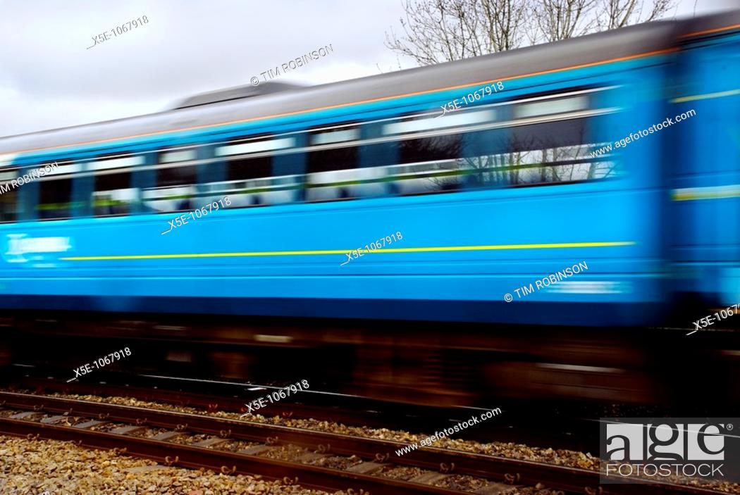 Stock Photo: Blue railway carriage in motion.