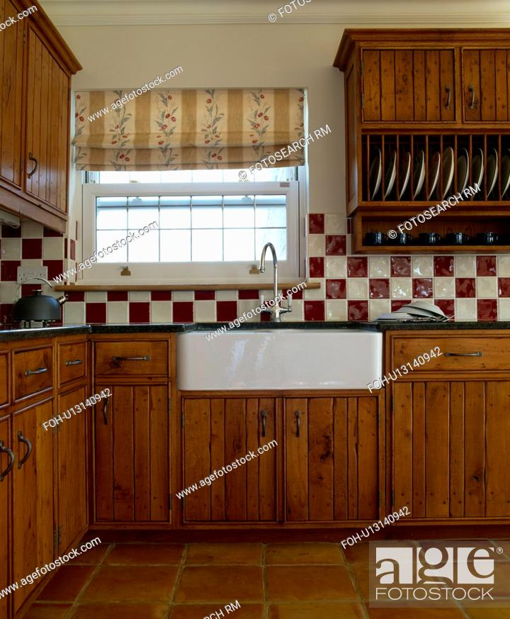 Red And White Wall Tiles In Country Kitchen With Fitted Oak Units Stock Photo Picture And Rights Managed Image Pic Foh U13140942 Agefotostock