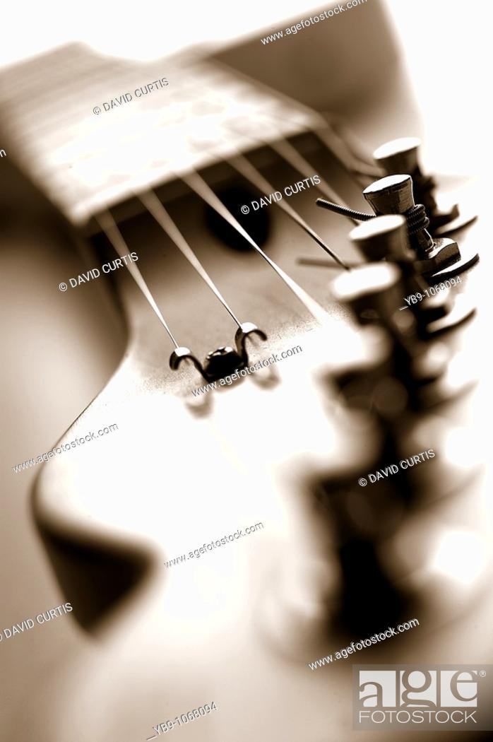 Stock Photo: close up of head of guitar.