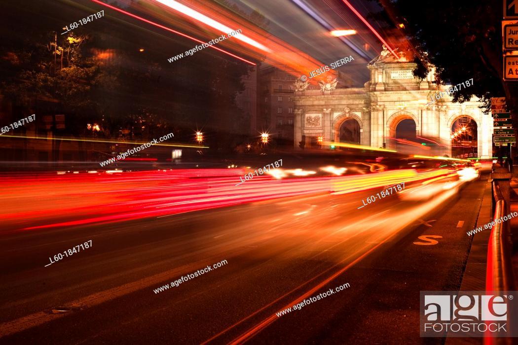 Photo de stock: Red lights in Puerta de Alcalá, Madrid, Spain.