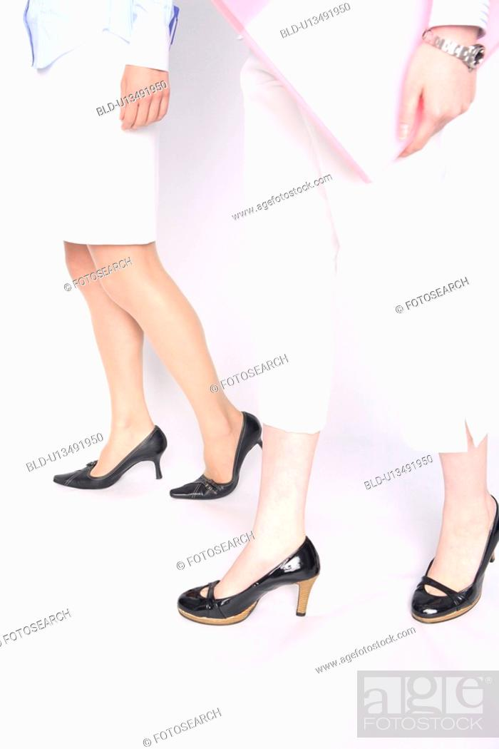 Stock Photo: Foot of the business lady.