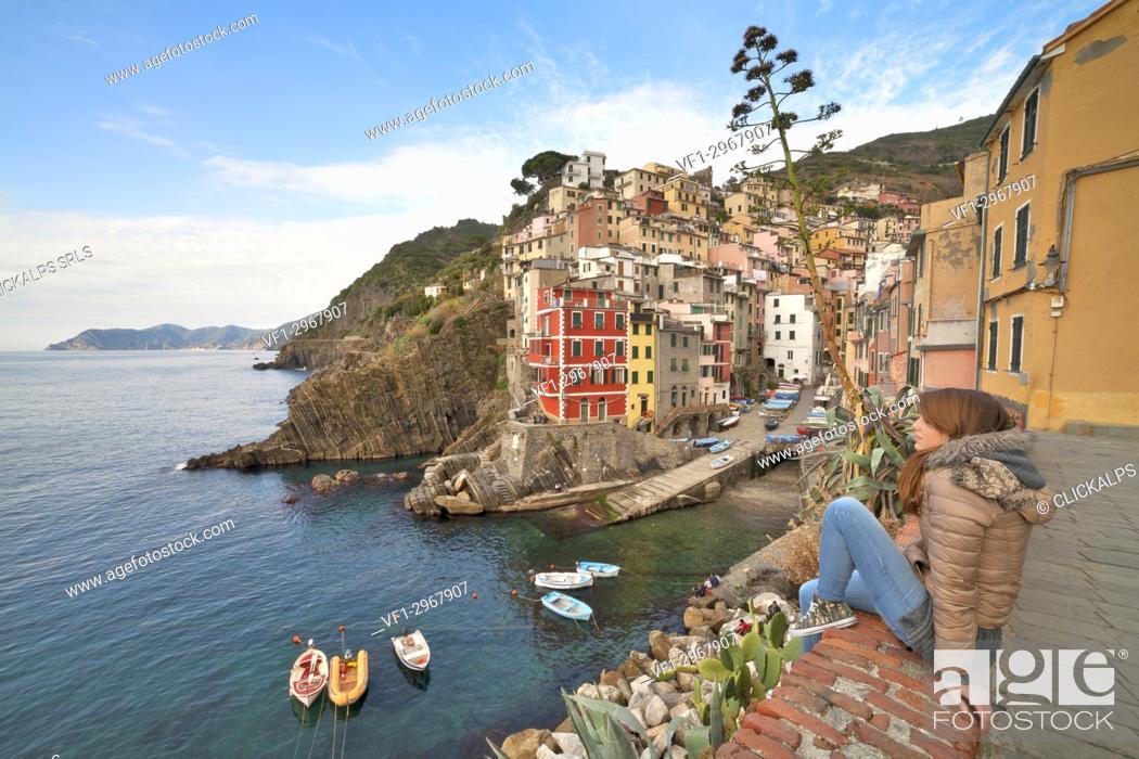 Stock Photo: Woman enjoying landscape at Riomaggiore, La Spezia, liguria, North Italy, Italy.