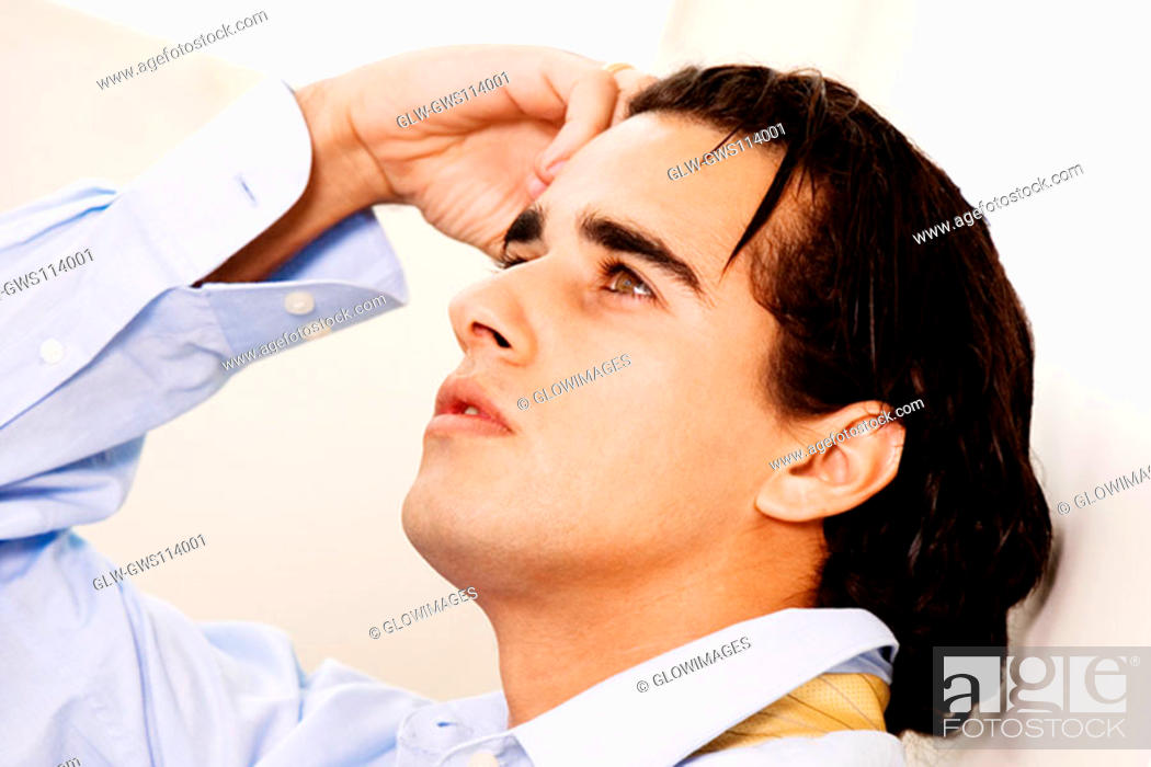 Stock Photo: Close-up of a businessman looking up.