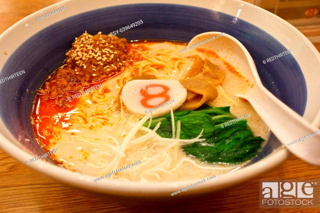 Stock Photo: pork bone soup noodle with spicy ground pork garnished with Japanese spring onion, pak choi, kamaboko, sesame seeds and memma.