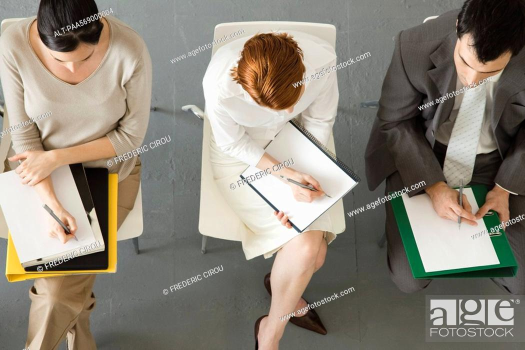 Stock Photo: Business people taking notes during meeting.