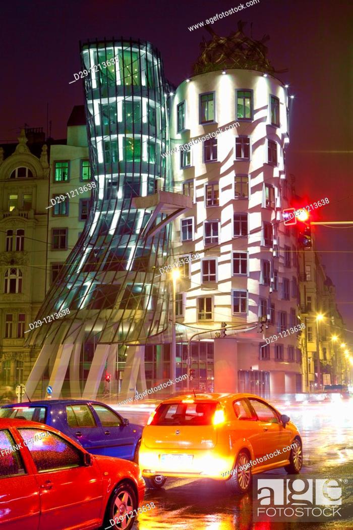 Stock Photo: prague, czech republic - the dancing house and traffic in rain.