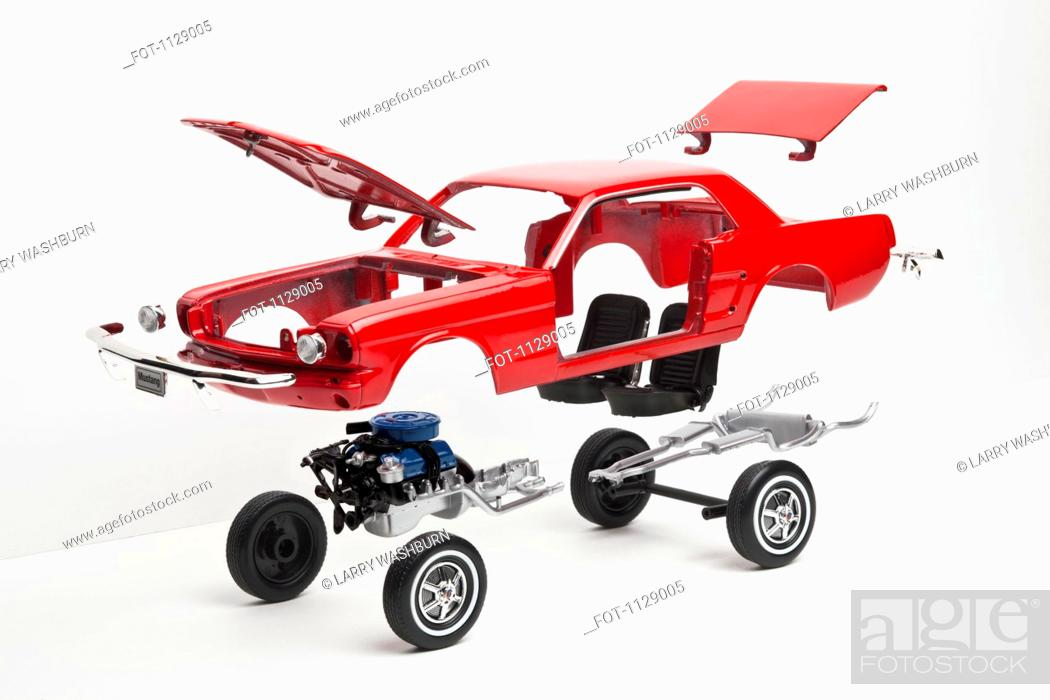 Stock Photo: A model car taking a part, some pieces in mid-air.