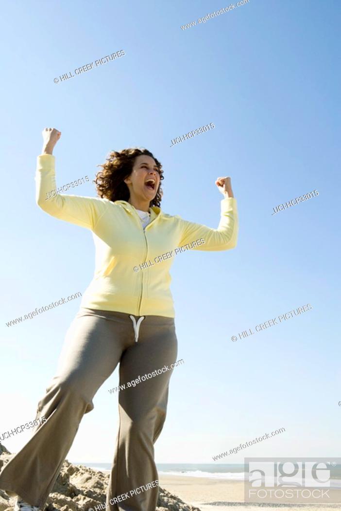 Stock Photo: Women exercising on beach.