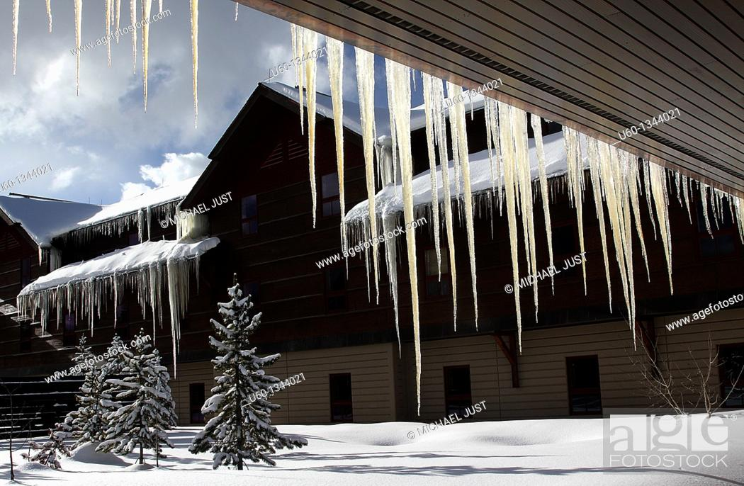 Stock Photo: Giant icicles form during the winter at old Faithful's Snow Lodge at Yellowstone National Park,Wyoming.