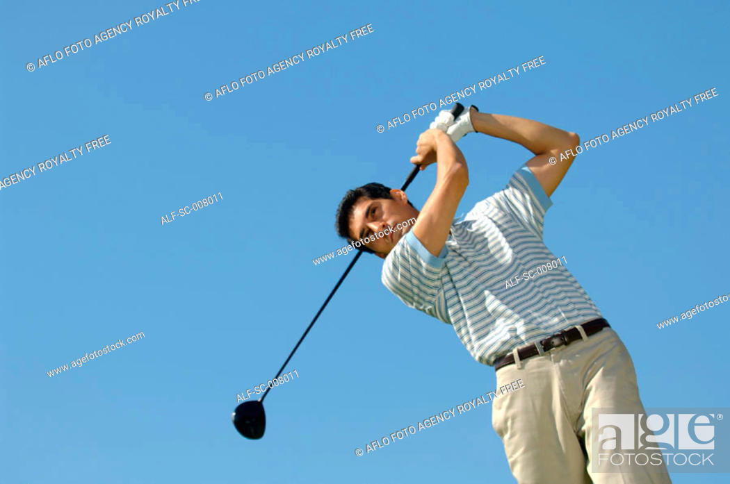 Stock Photo: Portrait of a man making a golf swing.