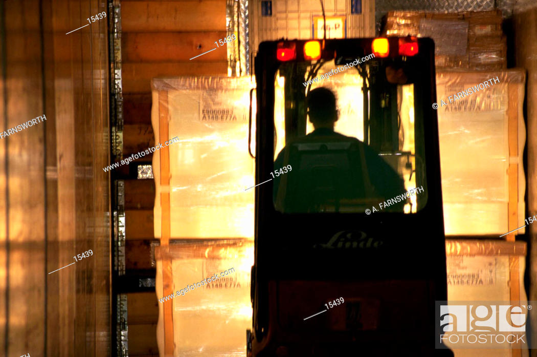 Stock Photo: Forklift in warehouse.