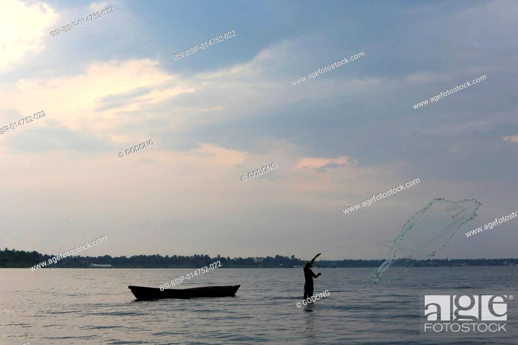 Stock Photo: African fisherman with nets on Lake Togo.