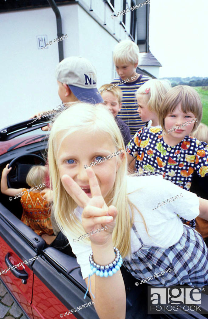 Stock Photo: Five children, four boys, a little girl, 1-5 5-10 years old, sitting in a car, cabriolet.