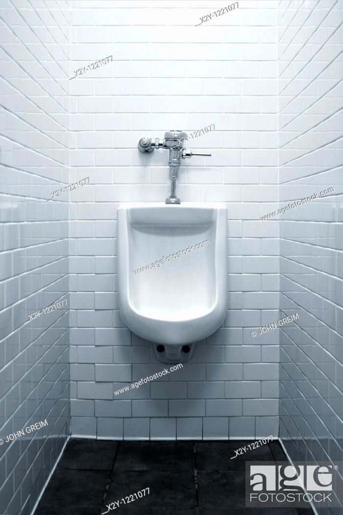 Stock Photo: Urinal in men's restroom.