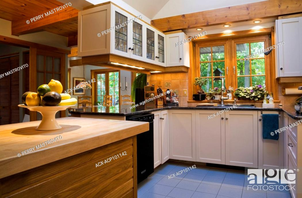 Kitchen With Maple Wood Island White Wooden Cabinets And Black Granite Countertops Inside A Stock Photo Picture And Rights Managed Image Pic Acx Acp101142 Agefotostock