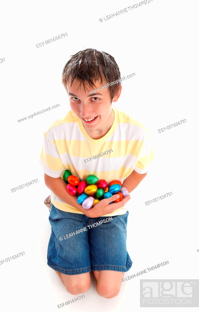 Stock Photo: Boy holding lots of easter eggs.