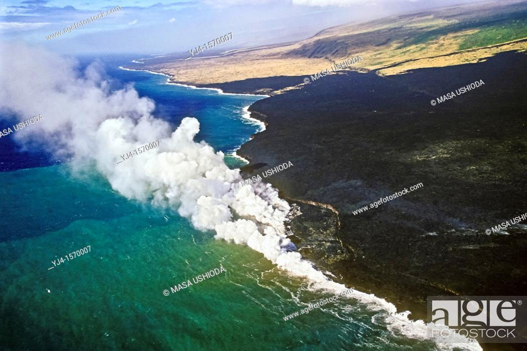 Stock Photo: aerial view of lava ocean entry showing lava delta and bench - hot molten lava fed from multiple underground lava tubes, creating massive steam clouds as it.