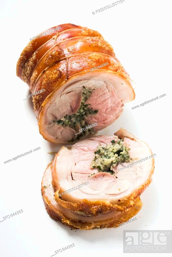 Stock Photo: Rolled pork roast with herb stuffing and crackling.