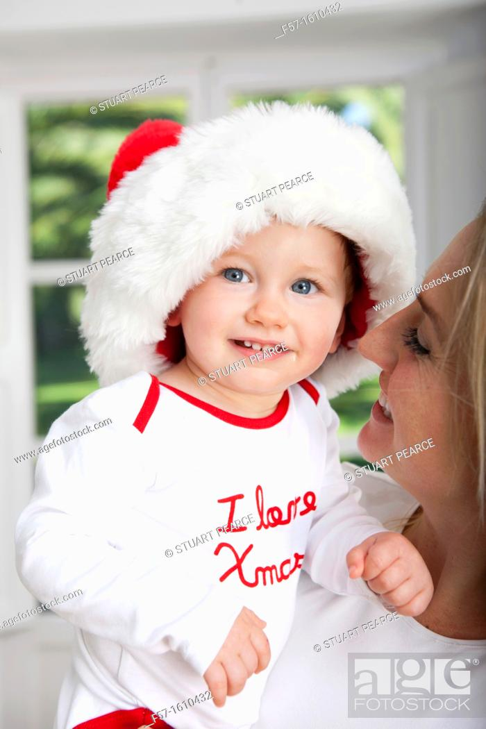 Stock Photo: Mother and son at Christmas time.