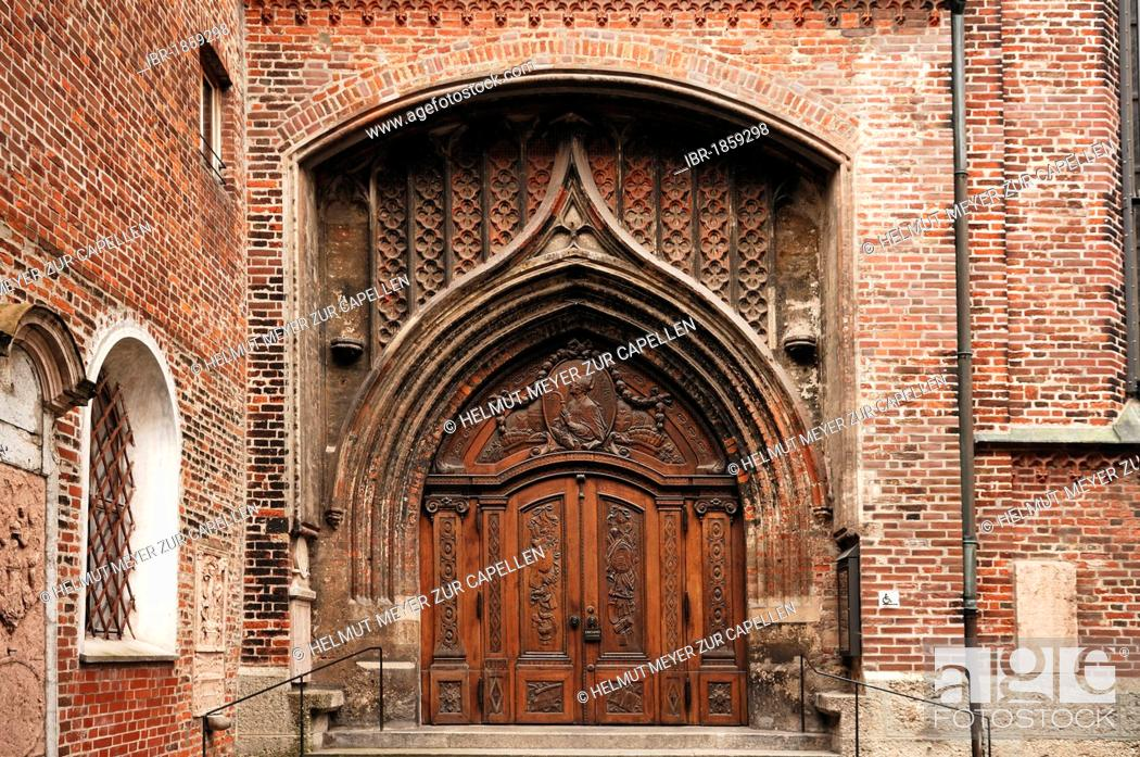 Stock Photo: Carved door of a side portal of the Church of Our Lady, Frauenplatz 12, Munich, Bavaria, Germany, Europe.