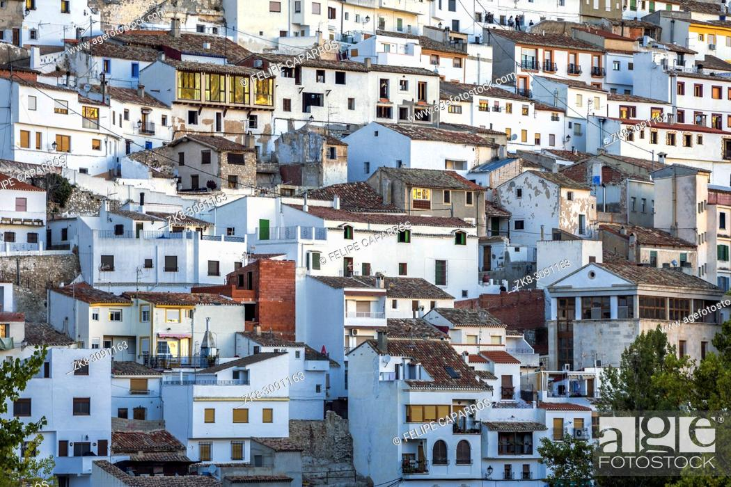 Stock Photo: Houses and roofs next to mountain limestone, view to the mountains of the river Jucar, take in Alcala del Jucar, Albacete province, Spain.
