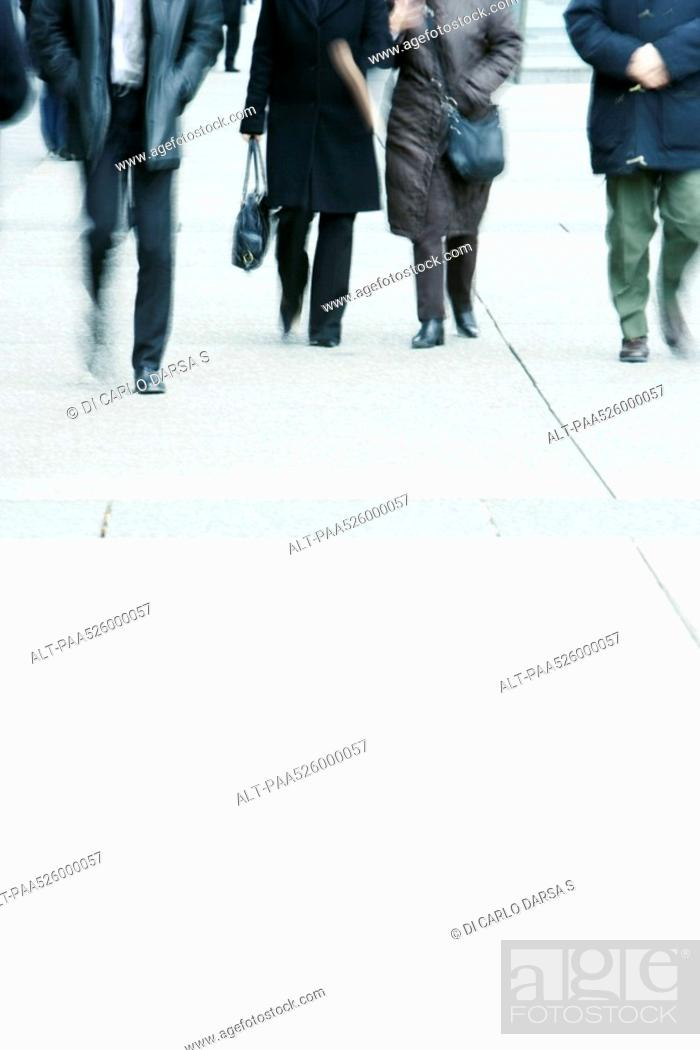 Stock Photo: Cropped view of pedestrians on sidewalk.