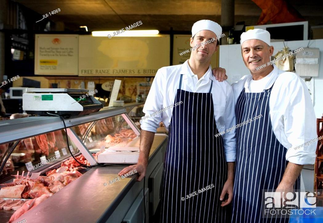 Stock Photo: Butchers in shop, smiling, portrait.
