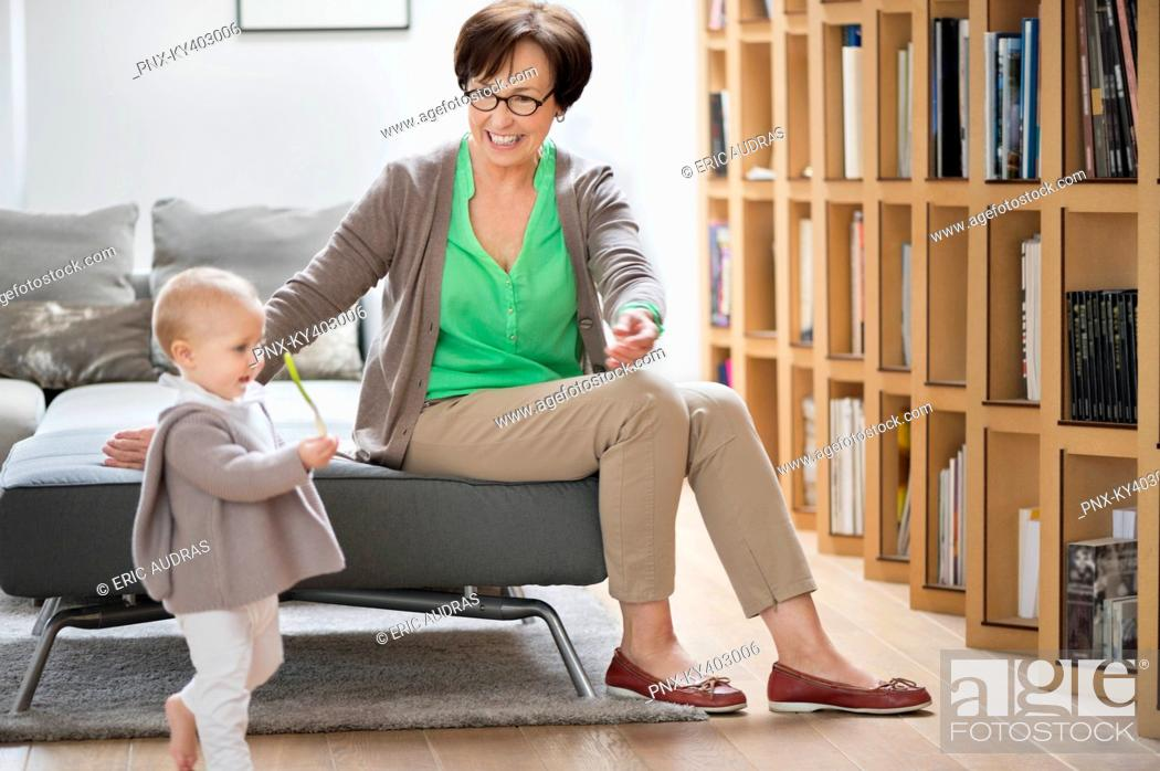 Stock Photo: Woman playing with her granddaughter.