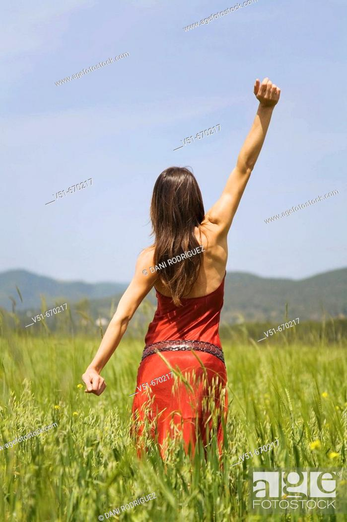 Stock Photo: Young woman in the countryside.