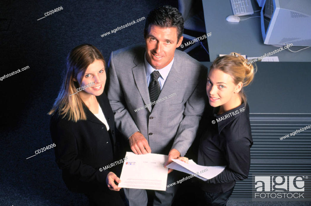 Stock Photo: Three businesspeople with files looking at camera.
