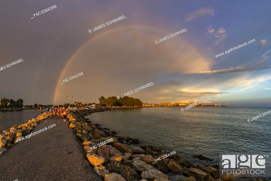 Stock Photo: Full rainbow over Gulf of Mexico shore at the South Jetty in Venice Florida.