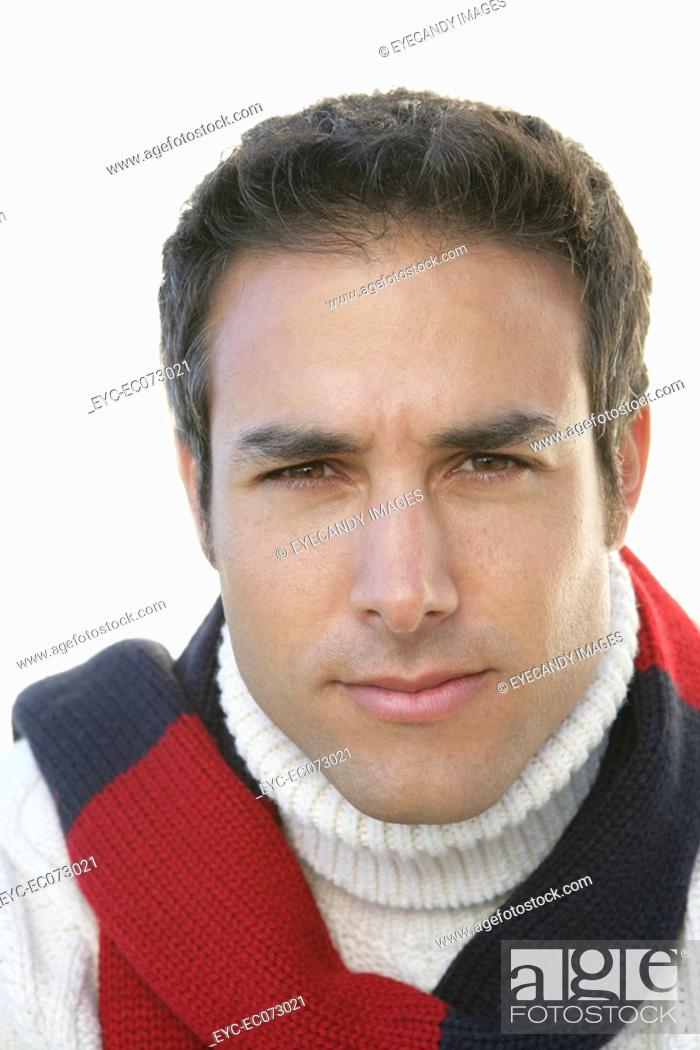 Stock Photo: Portrait of young man in winter clothing.