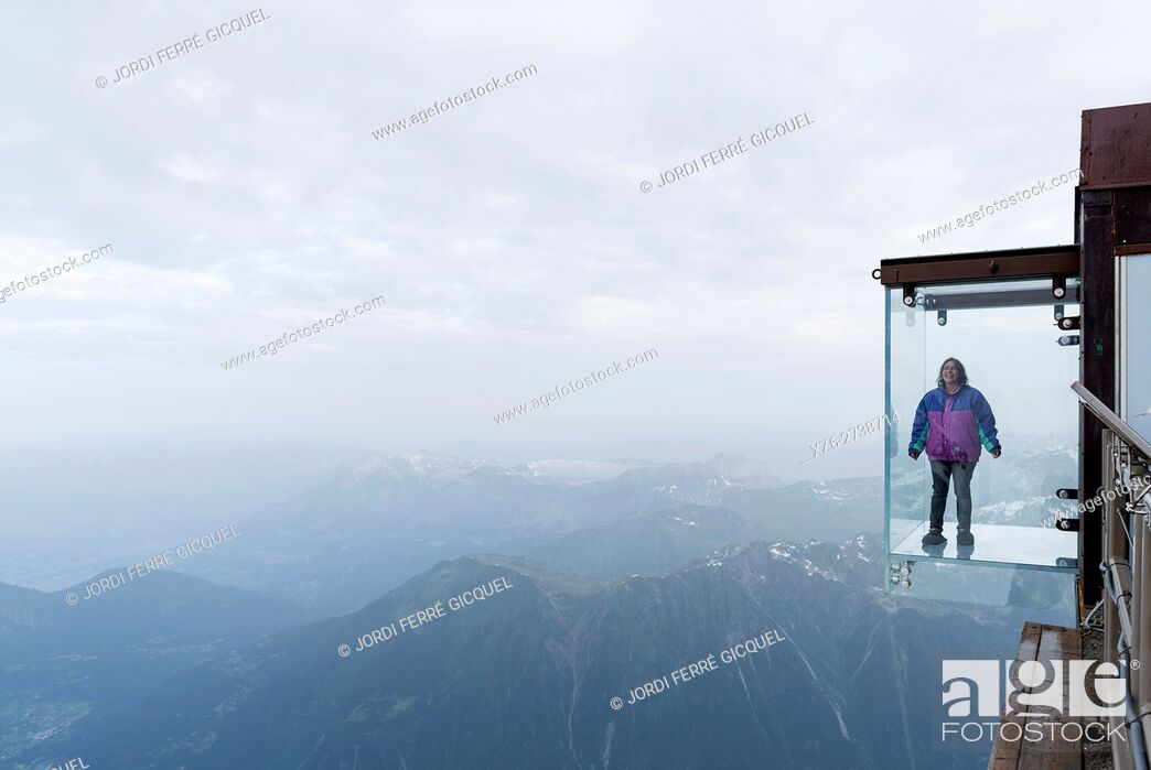 Stock Photo: Woman in a crystal box on the void, Pas dans le Vide - step into the void - at 3842 m, Aiguille du Midi, Chamonix-Mont-Blanc, Haute-Savoie, France, Europe.