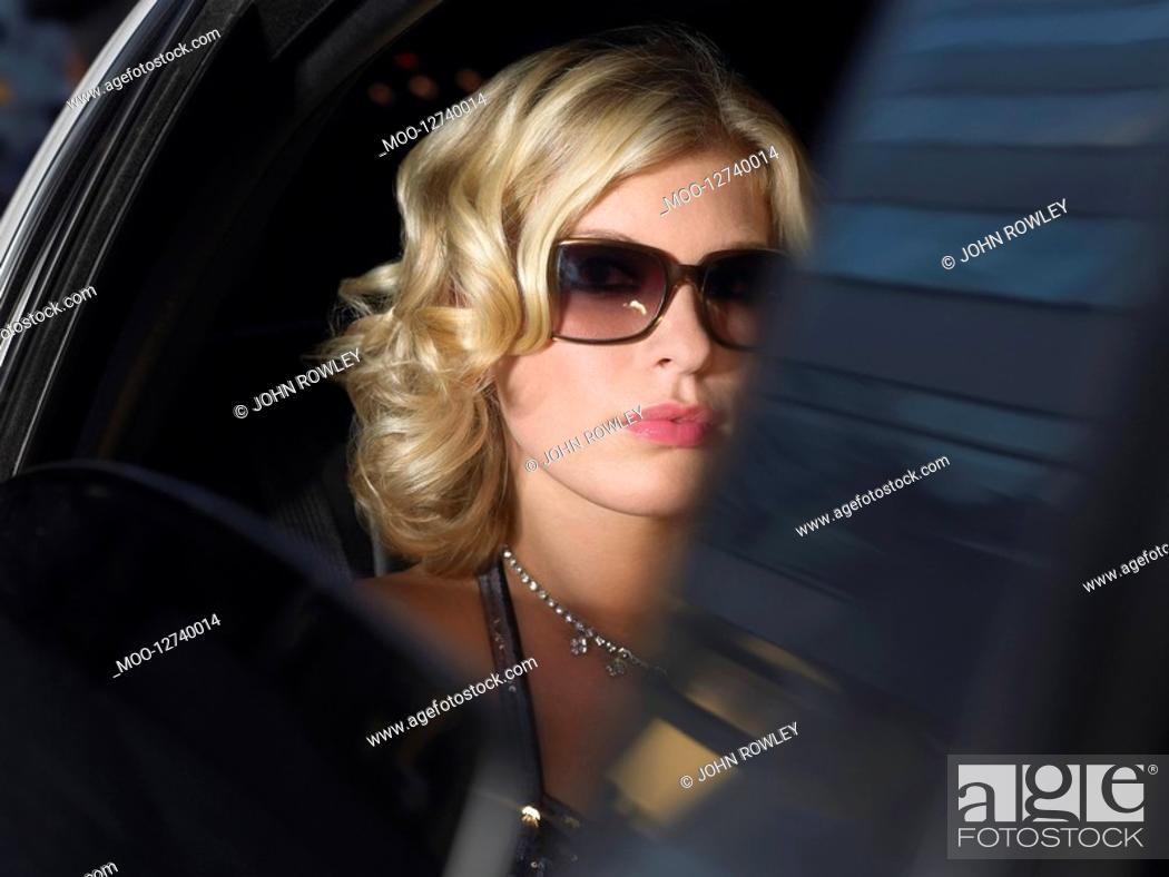 Stock Photo: Woman in back of limousine.