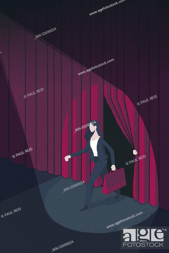 Imagen: Spotlight on businesswoman on stage.