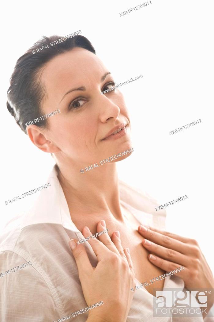 Stock Photo: woman creaming neckline.