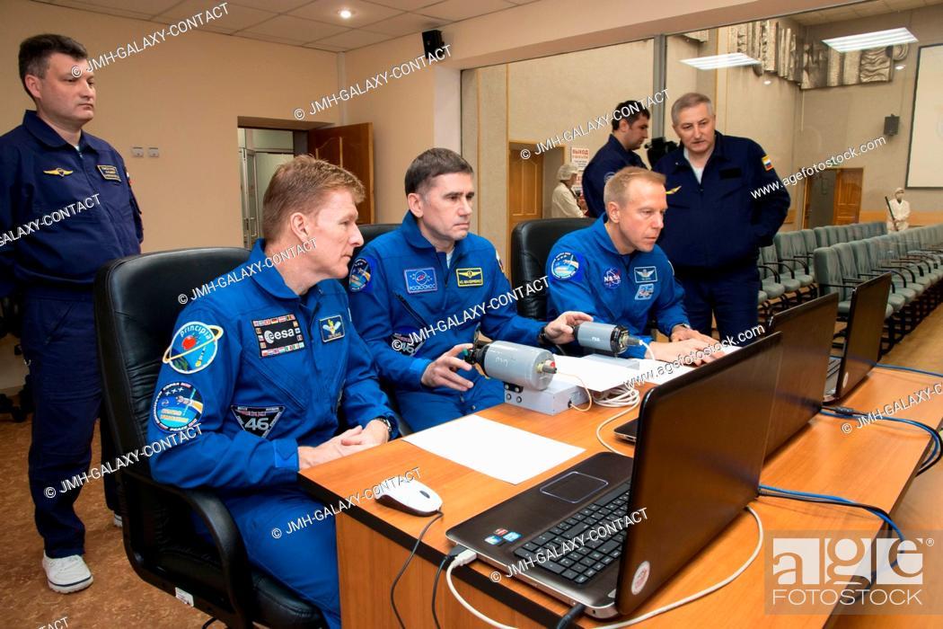 Stock Photo: At their Cosmonaut Hotel crew quarters in Baikonur, Kazakhstan, Expedition 46-47 crew members Tim Peake of the European Space Agency (left).