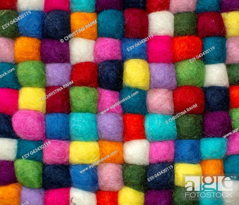 Stock Photo: Colorful felted little balls full frame decorative background.
