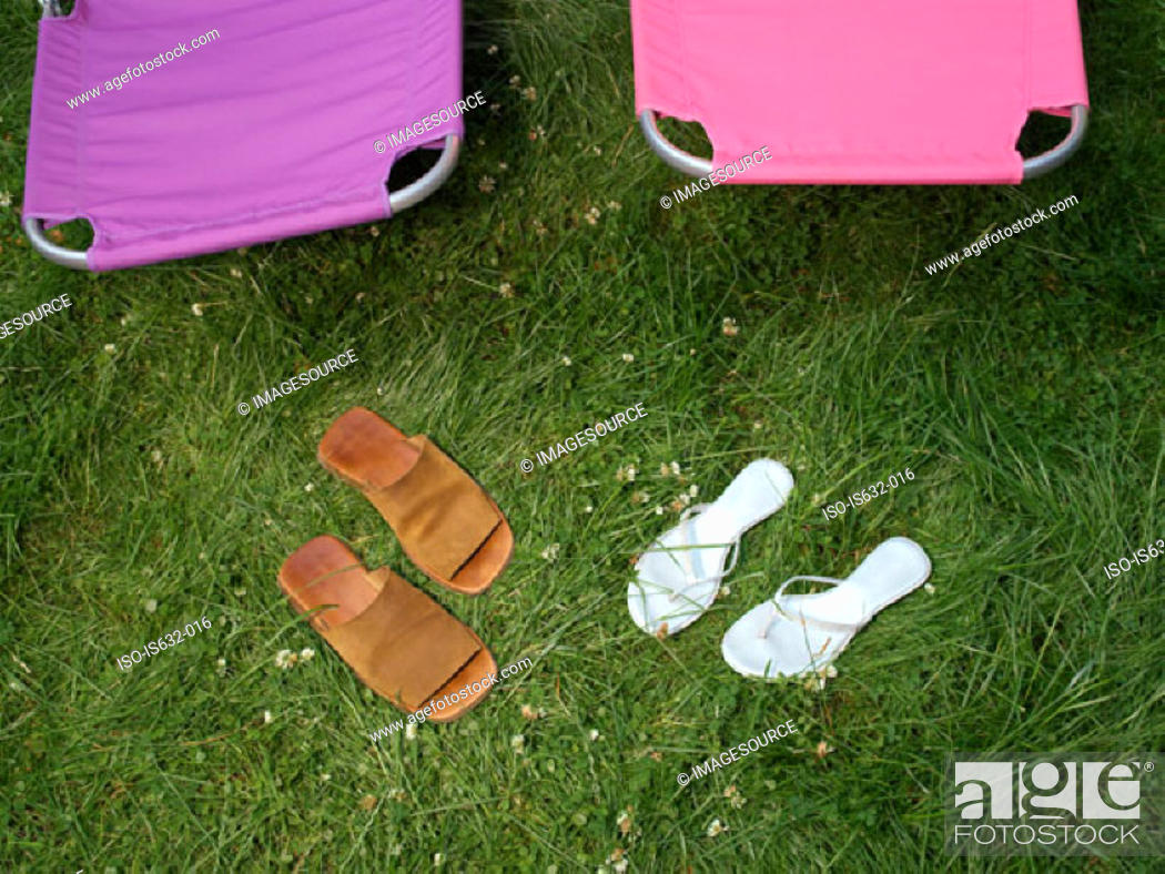 Stock Photo: Sandals and lounge chairs in garden.